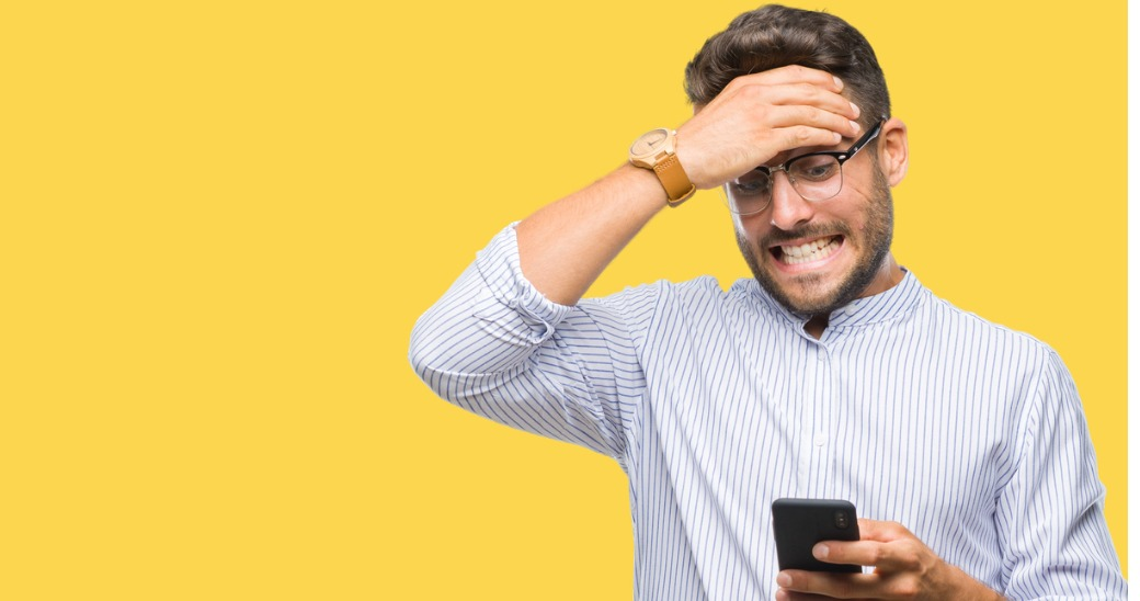 retail employee frustrated using phone